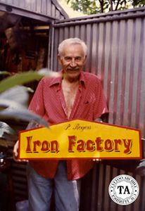 Paul Rogers holding The Iron Factory Sign